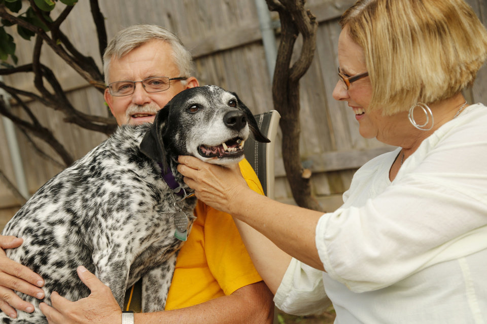 Photo - Gary Farnum and his wife Glenda relax in the backyard with their dog Horatio at their home in Oklahoma City, October 1, 2012. Photo by Doug Hoke, The Oklahoman