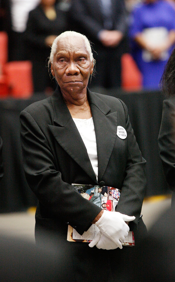 Photo - CLARA LUPER / MEMORIAL SERVICE / DEATH: A white-gloved woman was one of the ushers who helped people to their seats and distributed programs.  About 2,500 people celebrated the life and legacy of Oklahoma City civil rights pioneer Clara Mae Shepard Luper  during a lively service in the Cox Convention Center that lasted more than three hours, Friday,  June 17, 2011.  Luper died  last week at the age of 88. Photo by Jim Beckel, The Oklahoman ORG XMIT: KOD