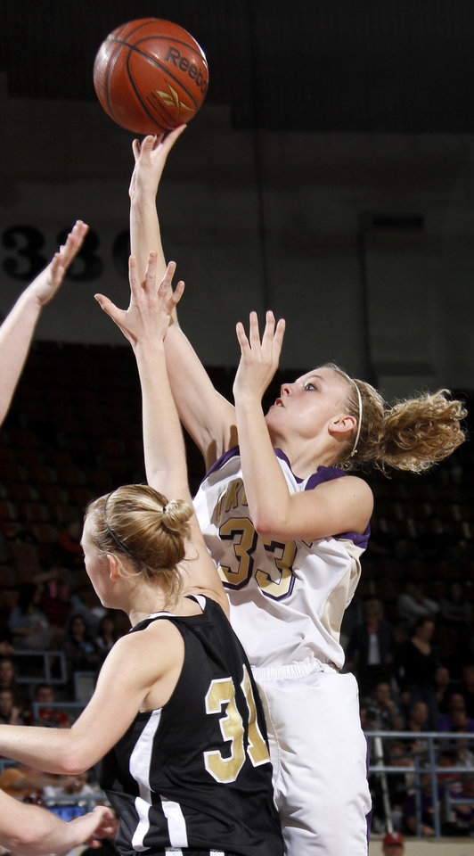 Photo - Okarche's Kristen Meyer shoots the ball beside Seiling's Chelsie Livingston during the Class A girls basketball state tournament at the State Fair Arena in Oklahoma City, Friday, March 5, 2010.  Photo by Bryan Terry, The Oklahoman