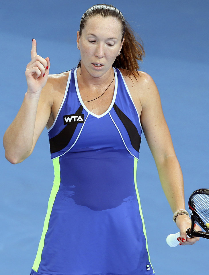 Photo - Jelena Jankovic of Serbia reacts after winning a point in her semifinal match against Victoria Azarenka of Belarus during the Brisbane International tennis tournament in Brisbane, Australia, Friday, Jan. 3, 2014. (AP Photo/Tertius Pickard)