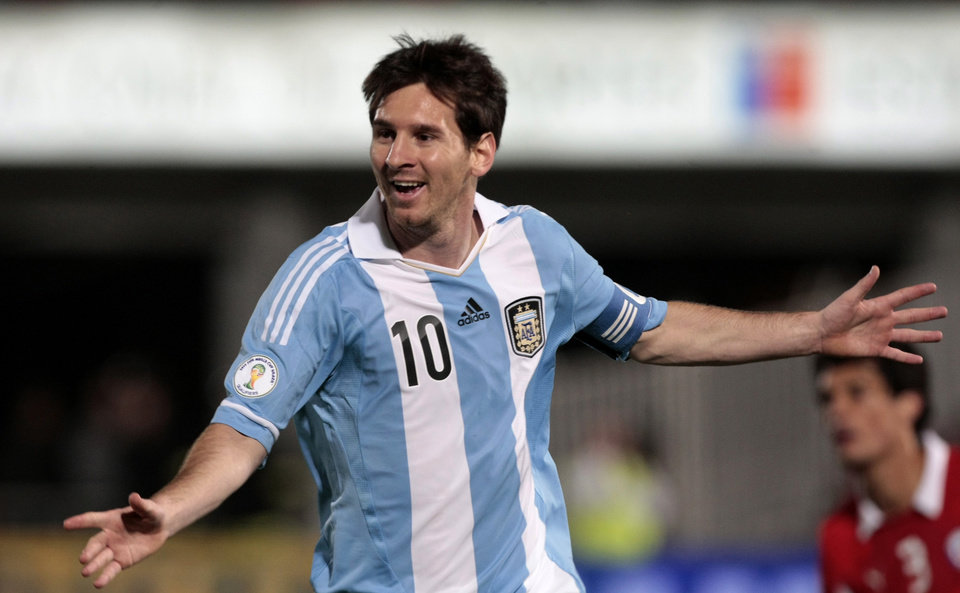 Photo -   Argentina's Lionel Messi celebrates after scoring against Chile during a World Cup 2014 qualifying soccer match in Santiago, Chile, Tuesday, Oct. 16, 2012. (AP Photo/Luis Hidalgo)