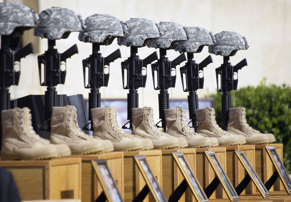 FILE - In this Nov. 10, 2009, file photo, a memorial to victims of the Fort Hood shooting is shown before the start of a memorial service, to be attended by President Barack Obama, at Fort Hood, Texas. Osama bin Laden is dead and there hasn't been a successful attack by al-Qaida-inspired extremists on U.S. soil since the deadly shooting rampage in Fort Hood, Texas, in 2009. But the danger of terrorism remains a reality for Americans, as seen in the attack in Libya in September that killed U.S. Ambassador Chris Stevens and three other Americans. (AP Photo/Donna McWilliam, File)