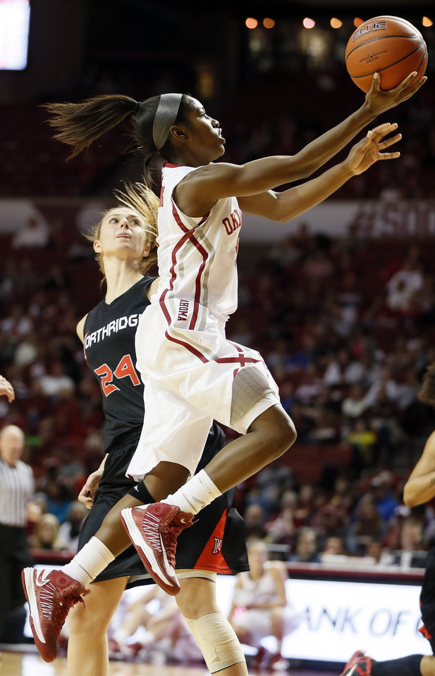 Photo - Oklahoma's Aaryn Ellenberg (3) shoots past Cal State Northridge's Marta Masoni (24) in the second half during a women's college basketball game between the University of Oklahoma (OU) and Cal State Northridge at the Lloyd Noble Center in Norman, Okla., Saturday, Dec. 29, 2012. OU won, 79-57.  Photo by Nate Billings, The Oklahoman