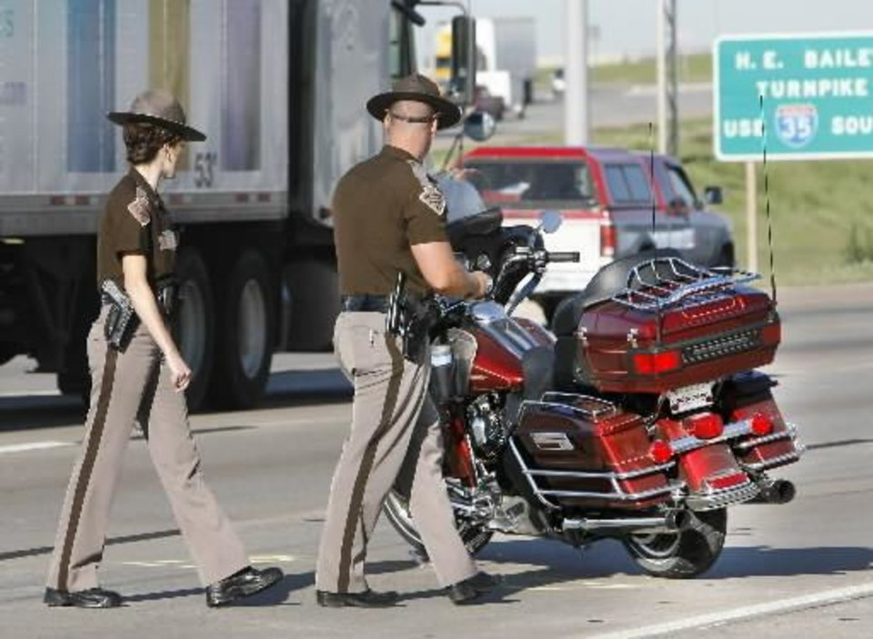 Photo - Oklahoma Highway Patrol Troopers investigate the scene of a fatality accident involving a motorcycle in the westbound lanes of I-40 just east of I-235 in Oklahoma City, OK, Friday, Aug. 21, 2009. By Paul Hellstern