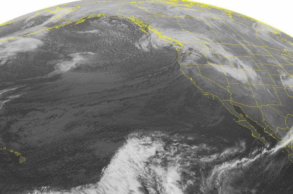 This NOAA satellite image taken Monday, Dec. 17, 2012 at 01:00 AM EST shows an area of clouds producing rain and mountain snow showers across the Northwest US and southern British Colombia associated with a strong area of low pressure. Clear skies are seen across the Southwest U.S. (AP Photo/Weather Underground)