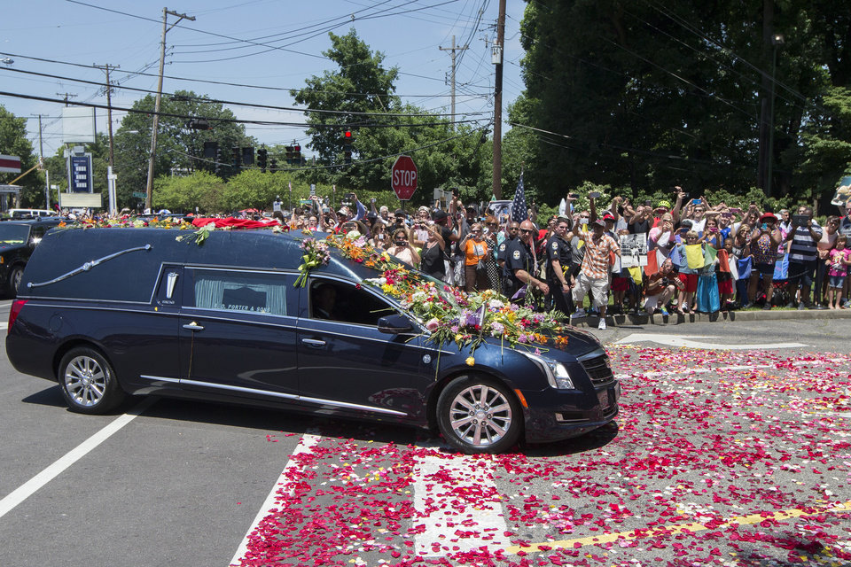 Photo - The hearse carrying Muhammad Ali arrives as spectators watch his funeral procession enter Cave Hill Cemetery, Friday, June 10, 2016, in Louisville, Ky.     (AP Photo/John Minchillo)