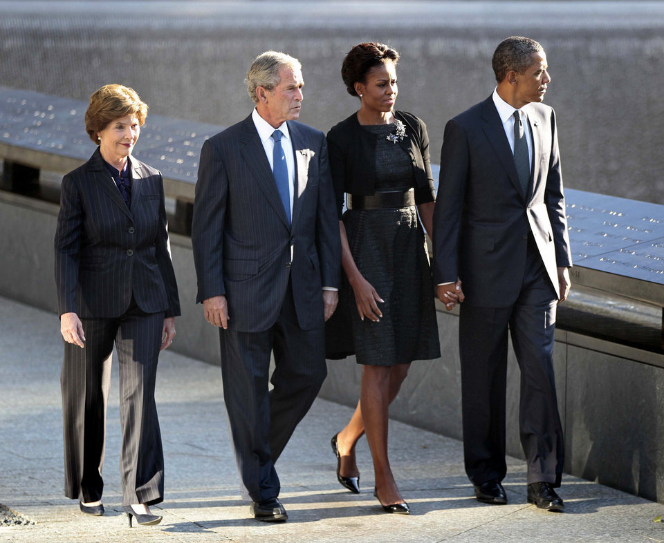 President Barack Obama and first lady Michelle Obama former President George W. Bush and former first lady Laura Bush visit North Memorial Pond at the National Sept. 11th Memorial Sunday, Sept., 11, 2011, in New York. (AP Photo/Pablo Martinez Monsivais)
