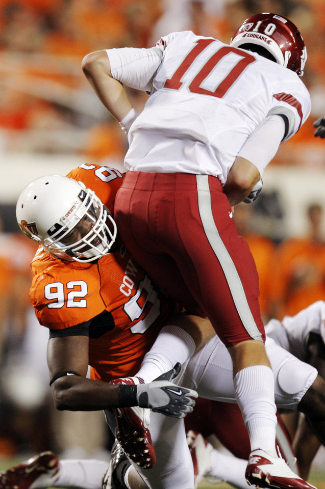 Photo - OSU's Darius Hart pressures WSU quarterback Jeff Tuel during the college football game between the Washington State Cougars (WSU) and the Oklahoma State Cowboys (OSU) at Boone Pickens Stadium in Stillwater, Okla., Saturday, September 4, 2010. OSU won, 65-17. Photo by Nate Billings, The Oklahoman