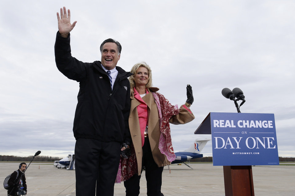 Republican presidential candidate and former Massachusetts Gov. Mitt Romney and wife Ann Romney wave to the crowd as they campaign at Portsmouth International Airport, in Newington, N.H., Saturday, Nov. 3, 2012. (AP Photo/Charles Dharapak)