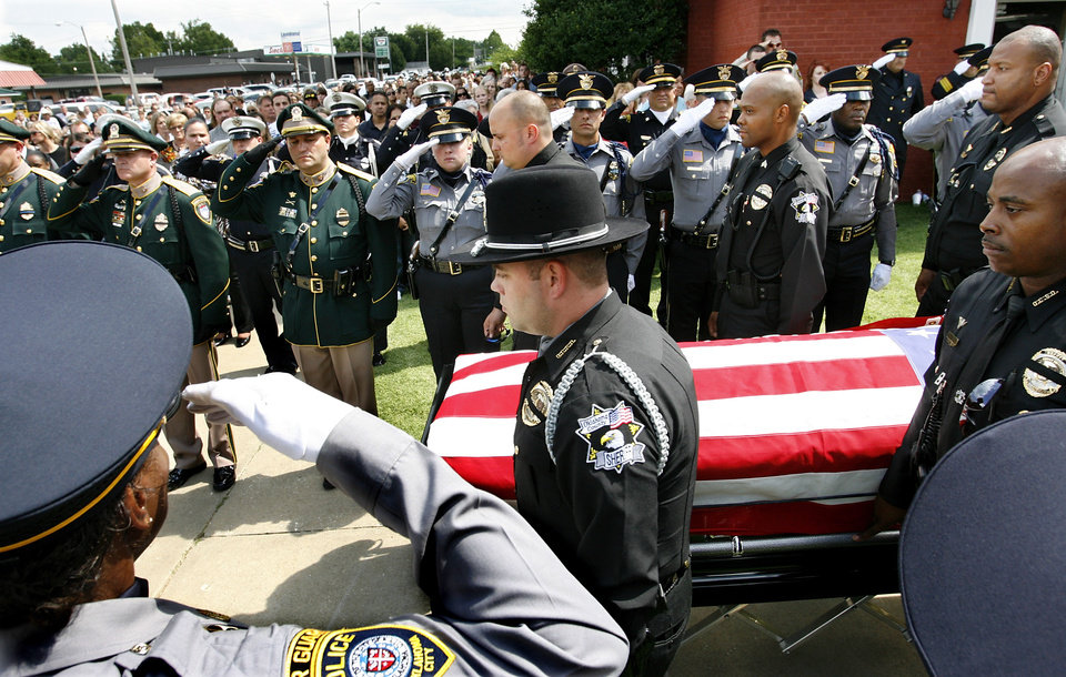 More than 1,200 mourners paid their final respects  to slain Seminole County Deputy Robbie Whitebird at his funeral in the First Baptist Church in Wewoka, Thursday afternon, July 30, 2009.   Photo by Jim Beckel, The Oklahoman