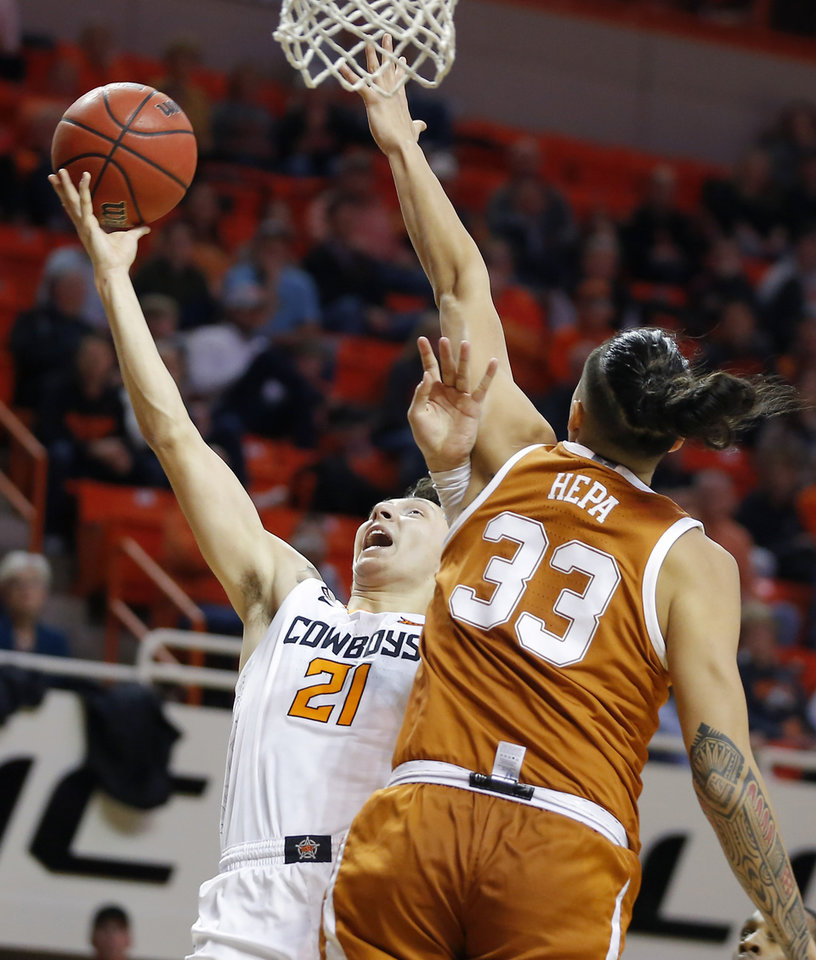 Photo - Oklahoma State's Lindy Waters III (21) goes to the basket past Texas' Kamaka Hepa (33) during an NCAA basketball game between the Oklahoma State University Cowboys (OSU) and the Texas Longhorns at Gallagher-Iba Arena in Stillwater, Okla., Wednesday, Jan. 15, 2020. [Bryan Terry/The Oklahoman]