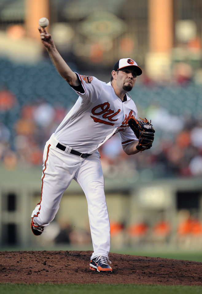 Photo -   Baltimore Orioles starting pitcher Jason Hammel delivers against the Los Angeles Angels during the second inning of a baseball game on Wednesday, June 27, 2012, in Baltimore. (AP Photo/Nick Wass)