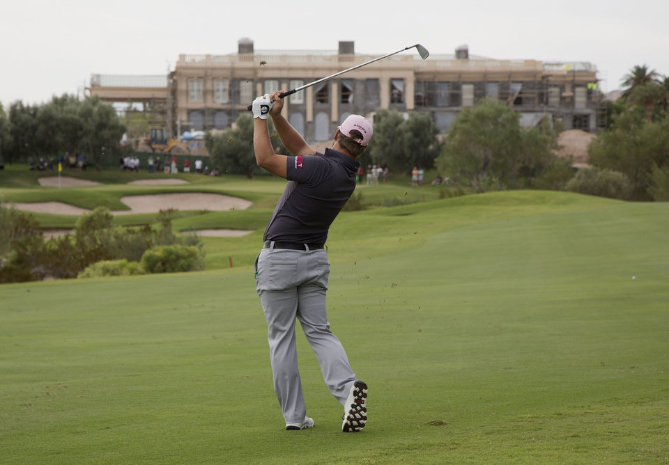 Photo -   Ryan Moore hits off the third fairway during the second round of the Justin Timberlake Shriners Hospitals for Children Open golf tournament, Friday, Oct. 5, 2012, in Las Vegas. (AP Photo/Julie Jacobson)