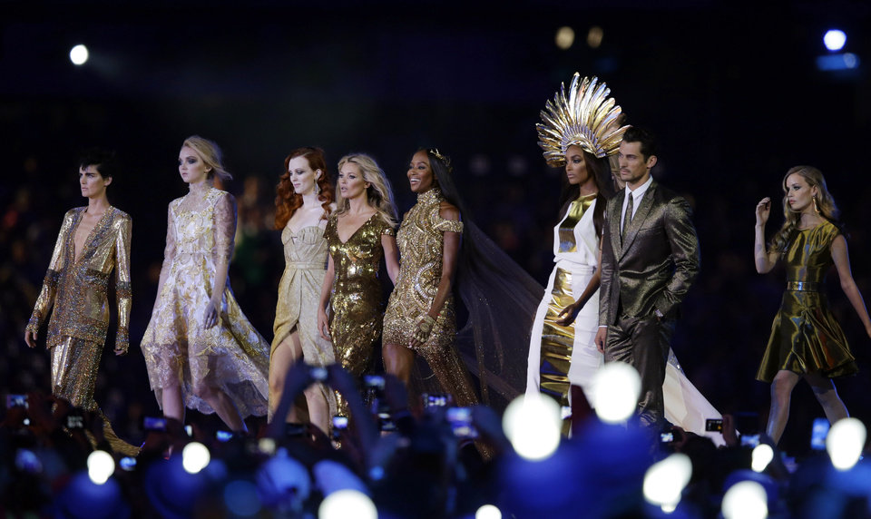 Photo -   British model Naomi Campbell, fourth right, walks with other models during the Closing Ceremony at the 2012 Summer Olympics, Sunday, Aug. 12, 2012, in London. (AP Photo/Matt Slocum)