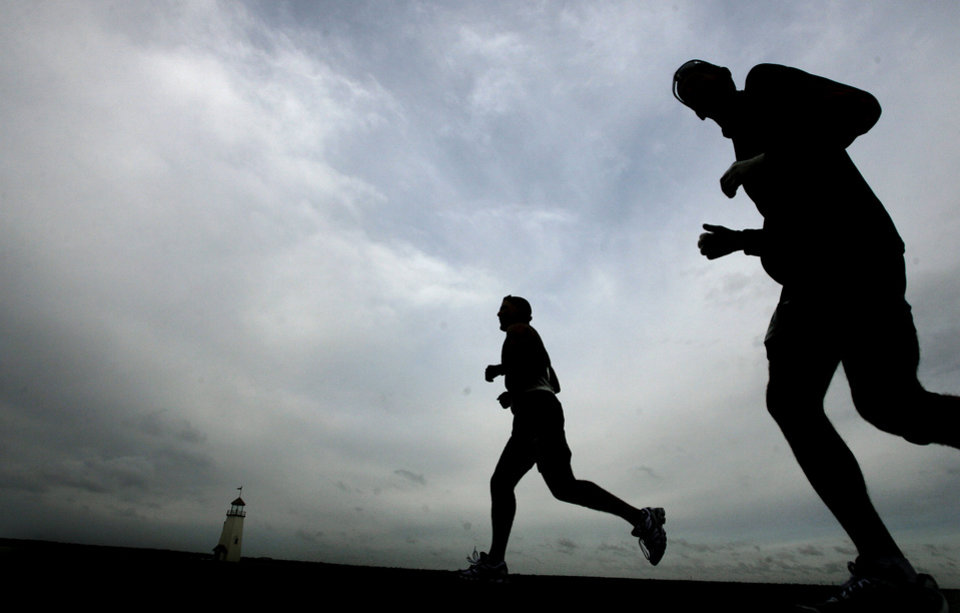 Marathon runners run on the Lake Hefner trail during the 8th annual Oklahoma City Memorial Marathon on Sunday, April 27, 2008, in Oklahoma City, Okla.