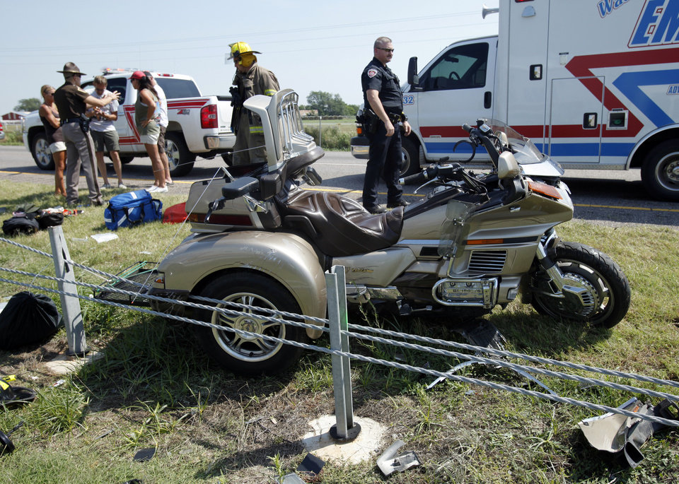 Photo - Two pedestrians were killed by an out of control vehicle on northbound Interstate 35 at the 102 marker and a female passenger on a motorcycle was killed when the driver swerved to avoid backed up traffic at the 98 mile marker and struck the cable barrier on Saturday, June 9, 2012, in Purcell, Okla.     Photo by Steve Sisney, The Oklahoman