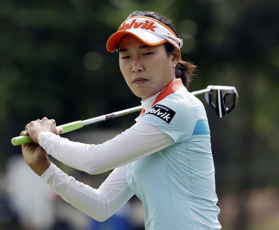 Ilhee Lee, of South Korea, reacts to a missed birdie putt on the 10th hole during the third round of the Kingsmill Championship LPGA golf tournament in Williamsburg, Va., Saturday, May 4, 2013.  (AP Photo/Steve Helber)