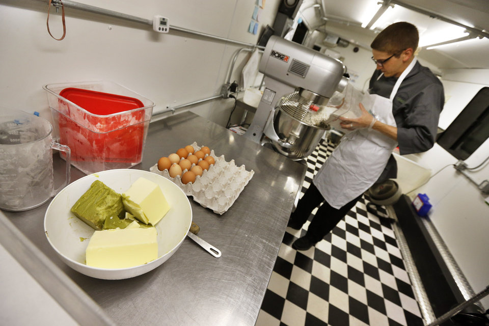 Photo - In this June 19, 2014 photo, chef Alex Tretter prepares a batter for peanut butter and jelly cups, with green cannabis-infused