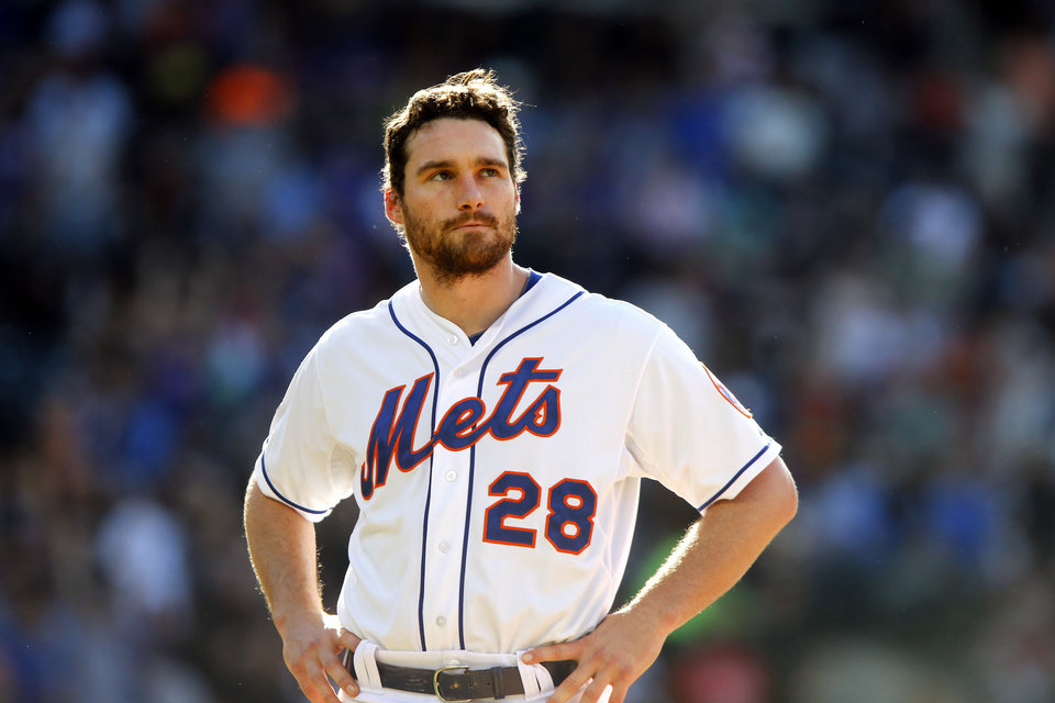 Photo - New York Mets' Daniel Murphy waits on the field before the sixth inning of a baseball game against the San Diego Padres, Saturday, June 14, 2014, in New York. (AP Photo/Jason DeCrow)