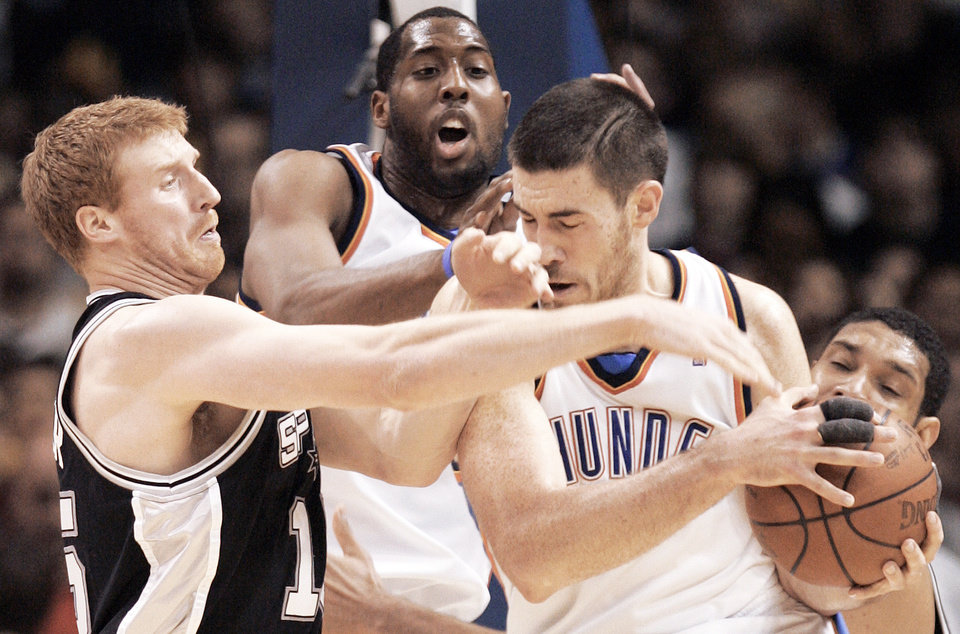 Photo - Oklahoma City's Nick Collison, right, and D.J. White fight for the ball against San Antonio's Matt Bonner during the Thunder's 99-89 loss to the Spurs on Tuesday night at the Ford Center.  Photo by Brenda O'Brian. The Oklahoman