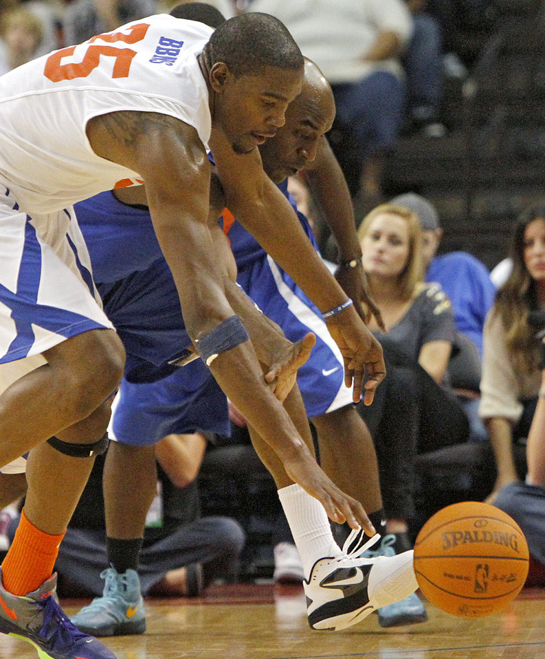 Photo - Kevin Durant and Damien Wilkins chase after a loose ball during the US Fleet Tracking Basketball Invitational at the Cox Convention Center in Oklahoma City Sunday, Oct. 23, 2011. The White Team defeated the Blue Team 176-171. Photo by John Clanton, The Oklahoman