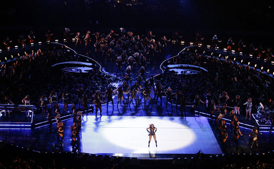 Photo - Beyonce performs during the halftime show of  the NFL Super Bowl XLVII football game between the San Francisco 49ers and the Baltimore Ravens, Sunday, Feb. 3, 2013, in New Orleans. (AP Photo/Charlie Riedel)