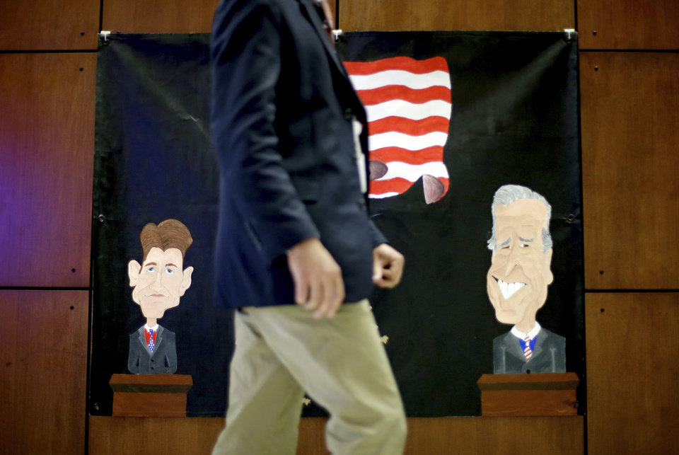 A banner made by a local middle school depicting Republican vice presidential candidate, Rep. Paul Ryan, R-Wis., at left, and Vice President Joe Biden, at right, hangs on the wall inside the media center ahead of Thursday's vice presidential debate, Wednesday, Oct. 10, 2012, at Centre College in Danville, Ky. (AP Photo/David Goldman)