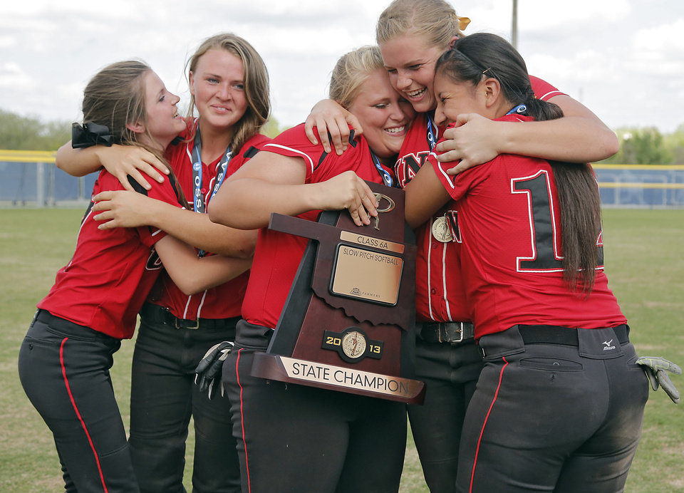 Tulsa Union teammates celebrate the win over Broken Arrow in the Class 6A Oklahoma State High School Slow Pitch Softball Championship at ASA Hall of Fame Stadium in Oklahoma City, Wednesday, May 1, 2013. Photo by Chris Landsberger, The Oklahoman