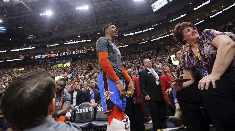 Photo - Oklahoma City Thunder's Russell Westbrook gets into a heated verbal altercation with fans in the first half of an NBA basketball game against the Utah Jazz, Monday, March 11, 2019, in Salt Lake City. (AP Photo/Rick Bowmer)