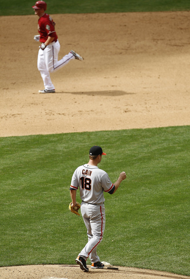 Photo -   San Francisco Giants' Matt Cain (18) walks off the mound after gving up a home run to Arizona Diamondbacks' Lyle Overbay during the sixth inning in an MLB baseball game Sunday, April 8, 2012, in Phoenix.(AP Photo/Ross D. Franklin)