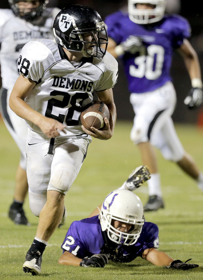 Photo - Perkins' Jacob Peyton rushes for a touchdown as Bethany's Nicholas Long misses a tackle during the high school football game between Bethany High School and Perkins in Bethany, Okla., Friday, Sept. 28, 2012.  Photo by Sarah Phipps, The Oklahoman