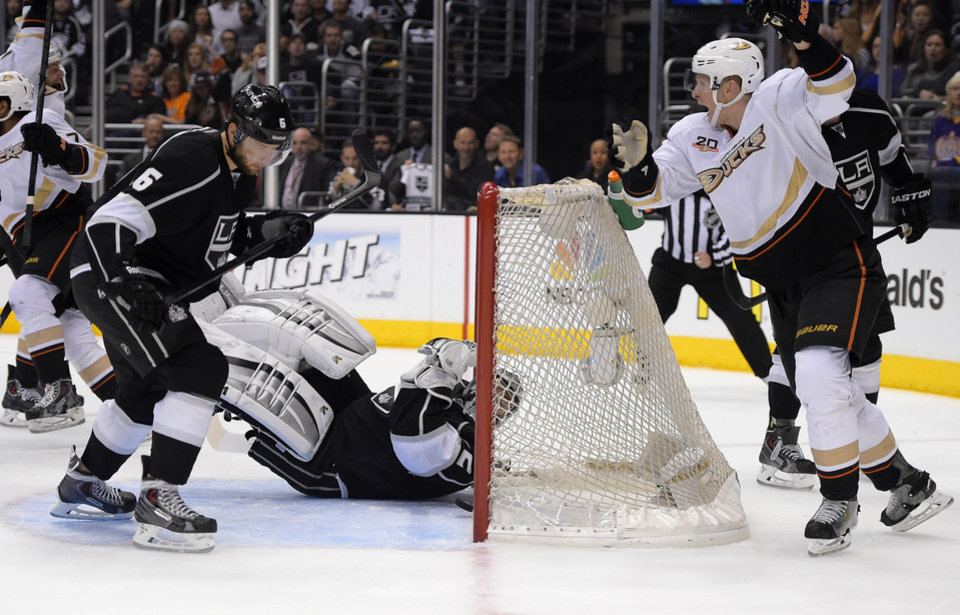 Photo - Anaheim Ducks right wing Corey Perry, right, celebrates a goal by right wing Devante Smith-Pelly, left, as Los Angeles Kings goalie Jonathan Quick, in goal, lays on the ice as defenseman Jake Muzzin looks on during the first period in Game 4 of an NHL hockey second-round Stanley Cup playoff series, Saturday, May 10, 2014, in Los Angeles. (AP Photo/Mark J. Terrill)