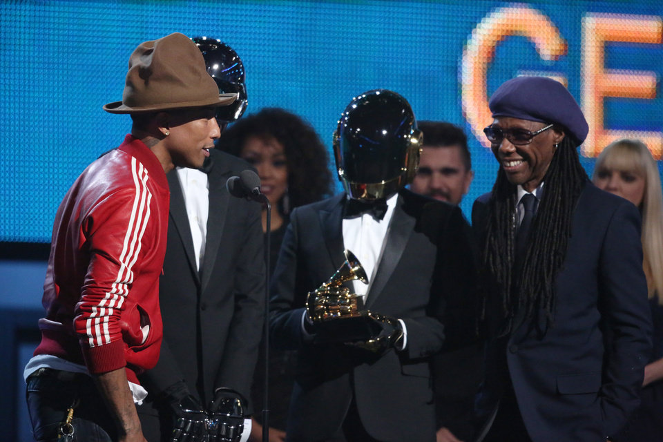 Photo - Pharrell Williams, from left, Daft Punk and Nile Rodgers accept the award for best pop duo/group performance at the 56th annual Grammy Awards at Staples Center on Sunday, Jan. 26, 2014, in Los Angeles. (Photo by Matt Sayles/Invision/AP)