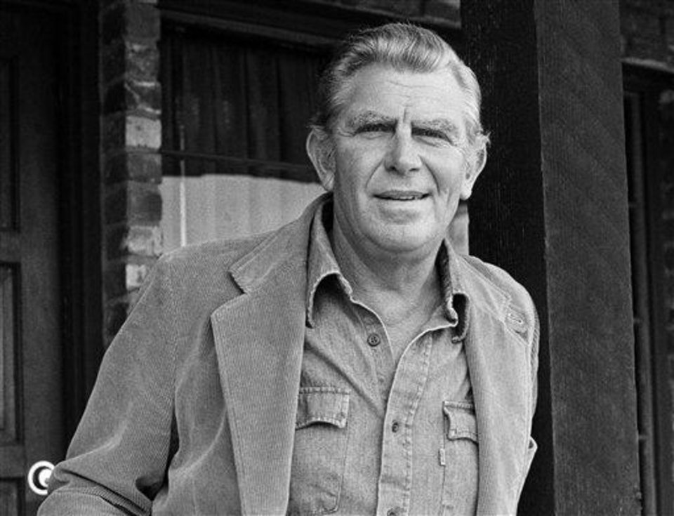 "FILE - This Jan. 31, 1983 file photo shows actor Andy Griffith posing in Los Angeles to promote his upcoming CBS-TV film, ""Murder in Coweta County"". Griffith, whose homespun mix of humor and wisdom made ""The Andy Griffith Show"" an enduring TV favorite, died Tuesday, July 3, 2012 in Manteo, N.C. He was 86. (AP Photo/Wally Fong, file)"