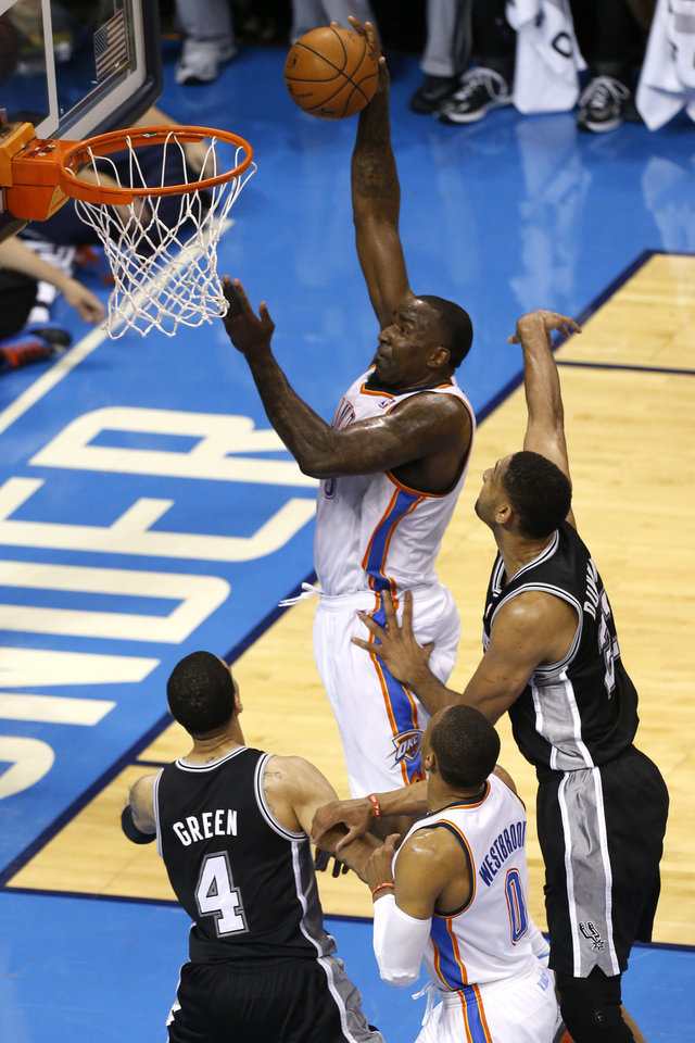 Photo - Oklahoma City's Kendrick Perkins (5) shoots as Russell Westbrook (0), San Antonio's Danny Green (4) and San Antonio's Tim Duncan (21) position for a rebound during Game 3 of the Western Conference Finals in the NBA playoffs between the Oklahoma City Thunder and the San Antonio Spurs at Chesapeake Energy Arena in Oklahoma City, Sunday, May 25, 2014. Photo by Nate Billings, The Oklahoman