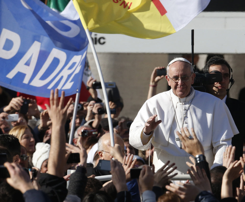 Pope Francis waves to crowds as he arrives to his inauguration Mass in St. Peter's Square at the Vatican, Tuesday, March 19, 2013. (AP Photo/Michael Sohn)