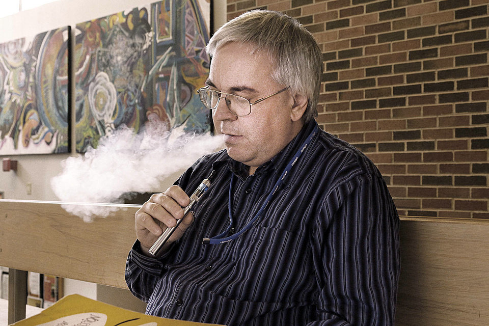 Todd Malicoate is a music professor at Oklahoma State University in Stillwater, OK, who uses an e-cigarette, Monday, October 21, 2013. The school is considering the banning of e-cigarettes.  Photo by Paul Hellstern, The Oklahoman