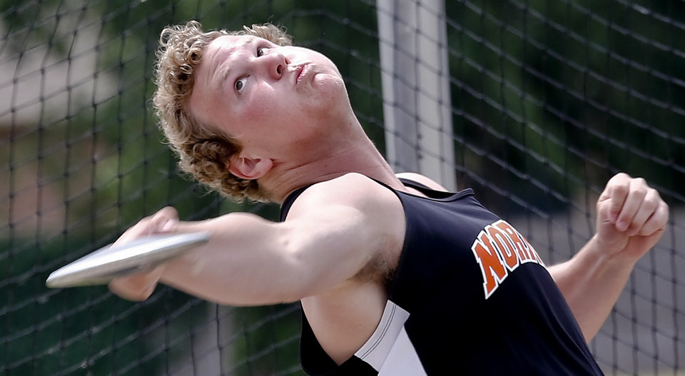 Photo - Norman's Cal Schone competes in the Class 6A boys discus during the Class 6A and 5A state championship track meet at Yukon High School on Saturday, May 17, 2014 in Yukon, Okla.   Photo by Chris Landsberger, The Oklahoman