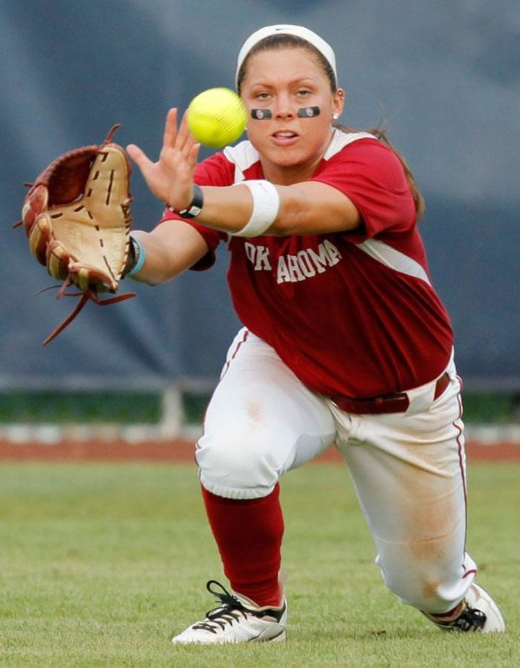 Photo -  OU's Haley Nix (5) catches a fly ball in the fifth inning during a Women's College World Series softball game between the University of Oklahoma and Arizona State University at ASA Hall of Fame Stadium in Oklahoma City, Thursday, June 2, 2011. ASU won, 3-1. Photo by Nate Billings, The Oklahoman