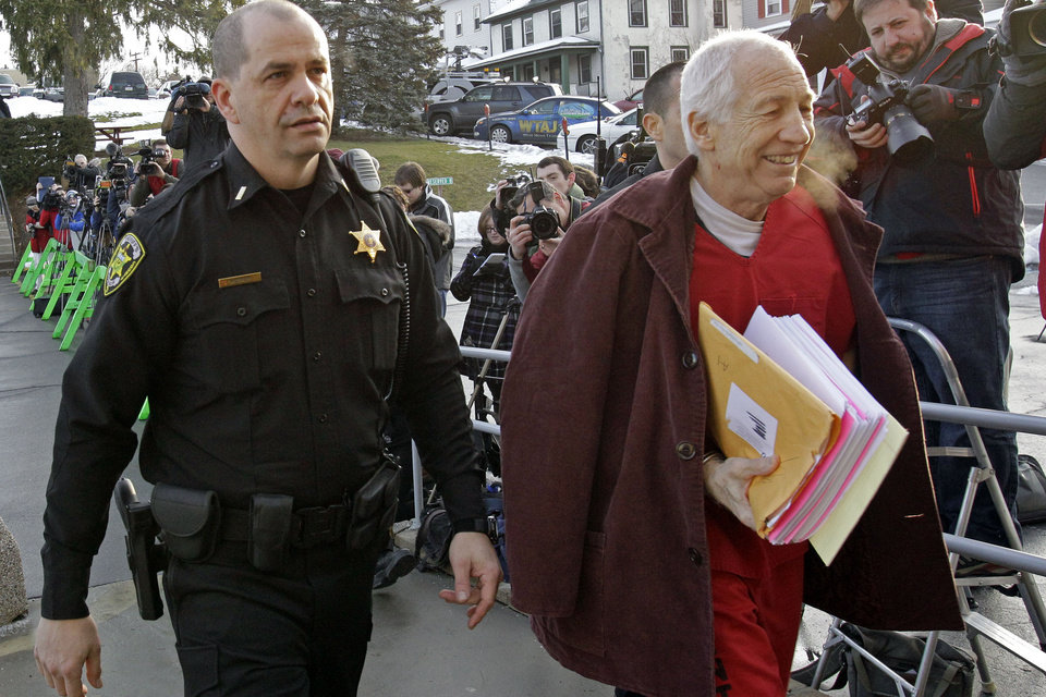 Former Penn State University assistant football coach Jerry Sandusky, right, arrives at the Centre County Courthouse for a post-sentence motion in Bellefonte, Pa., Thursday, Jan. 10, 2013. (AP Photo/Gene J. Puskar)