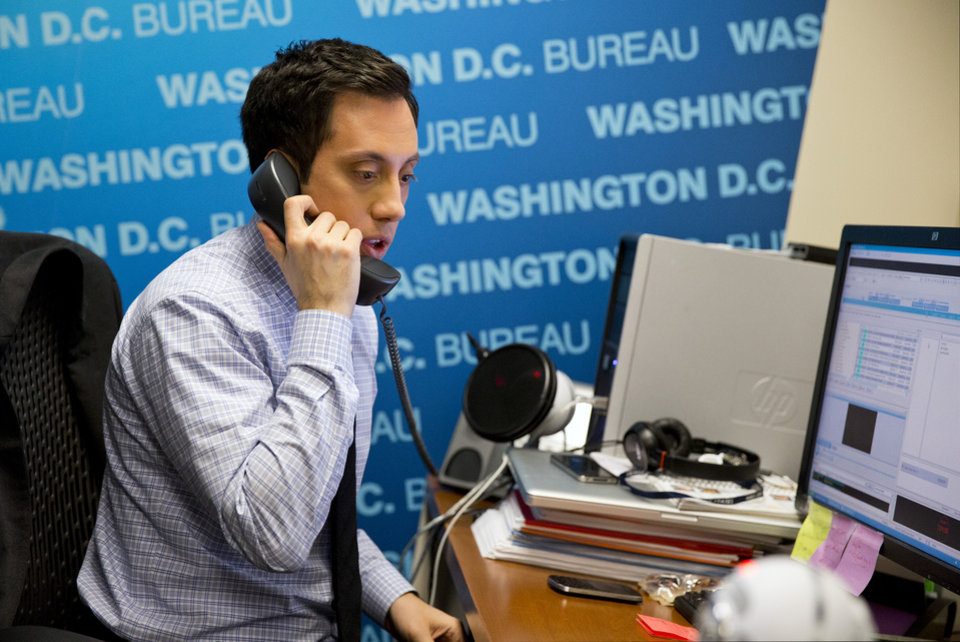Photo - NY1 political reporter Michael Scotto works in his office in Washington, Wednesday, Jan. 29, 2104, a day after being threatened by Rep. Michael Grimm, R-N.Y., after President Barack Obama's State of the Union address. The confrontation began when Scotto asked Grimm about a Justice Department investigation into his campaign finances. After cutting the interview short, Grimm told Scotto,