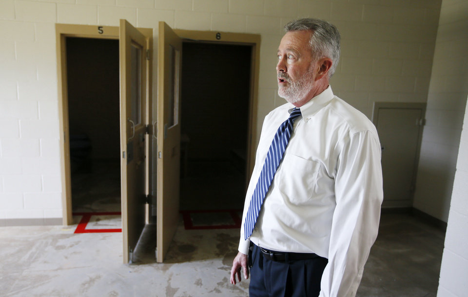 Photo -  Terry Smith, Office of Juvenile Affairs deputy director, is shown in a crisis-management unit at the Central Oklahoma Juvenile Center in Tecumseh. [Photo by Nate Billings, The Oklahoman]