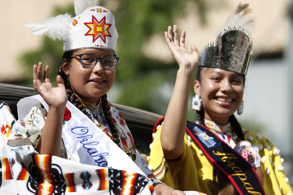 Photo -  A tribal princess waves to the crowd Saturday during the parade for the 2019 Red Earth Festival in downtown Oklahoma City.  [Paxson Haws photos/The Oklahoman]