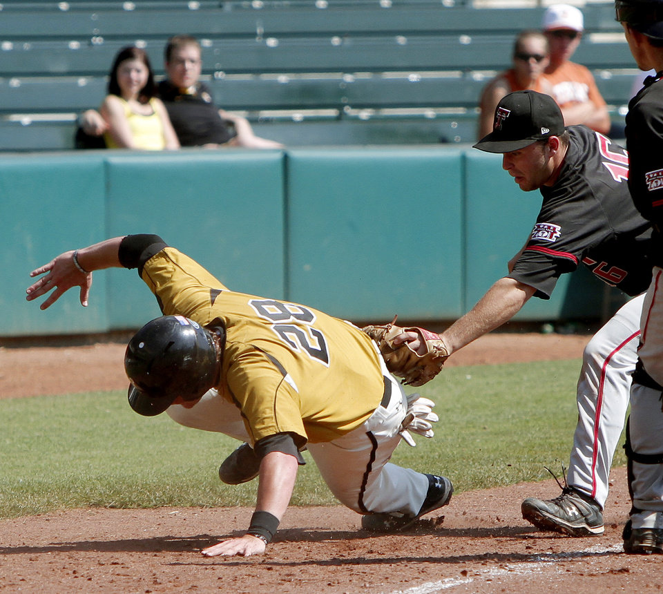 Texas Tech's Nick Popescu tags out Missouri's Conner Mach at third base in the fifth inning of a Big 12 baseball championship tournament game between Missouri and Texas Tech at the Bricktown Ballpark in Oklahoma City, Saturday, May 29, 2010.  Photo by Bryan Terry, The Oklahoman