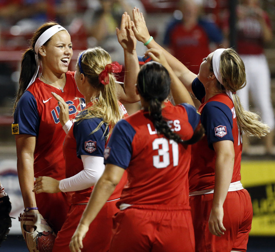 Team USA pitcher Keilani Ricketts (10), left, celebrates with her teammates after the championship game of the World Cup of Softball between the United States and Australia at ASA Hall of Fame Stadium in Oklahoma City, Monday, July 2, 2012. The USA won, 3-0. Photo by Nate Billings, The Oklahoman