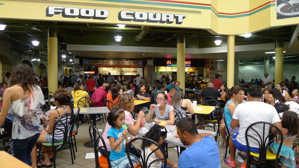 Photo - Shoppers visit the food court at La Gran Plaza in Fort Worth, Texas. The shopping center has become a model for Crossroads Mall's redevelopment plan.   - PROVIDED BY THE LEGASPI CO.