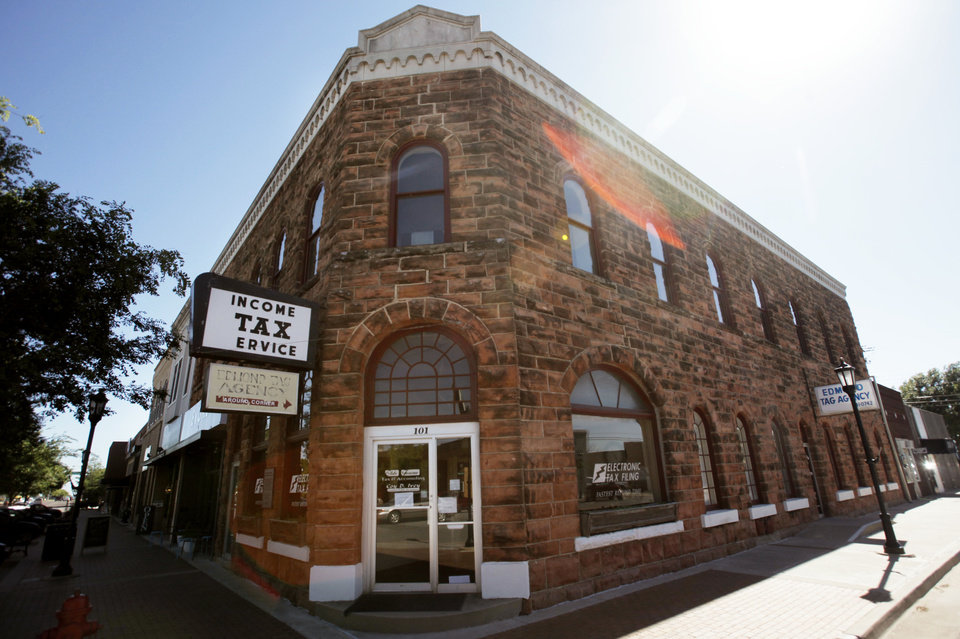 Photo - The oldest commercial building in Oklahoma county, built in 1893 and located at 101 S Broadway in Edmond. now houses several businesses. June 10, 2013. Photo by KT KING, The Oklahoman