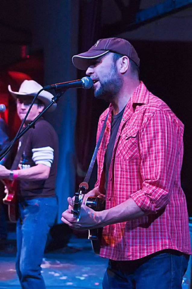 Photo - John Cooper of the Red Dirt Rangers performs at the 2011 Red Dirt Christmas at Cain's Ballroom in Tulsa. Photo provided by Stacey Lauren of C Sharp Studios - Cushing, OK