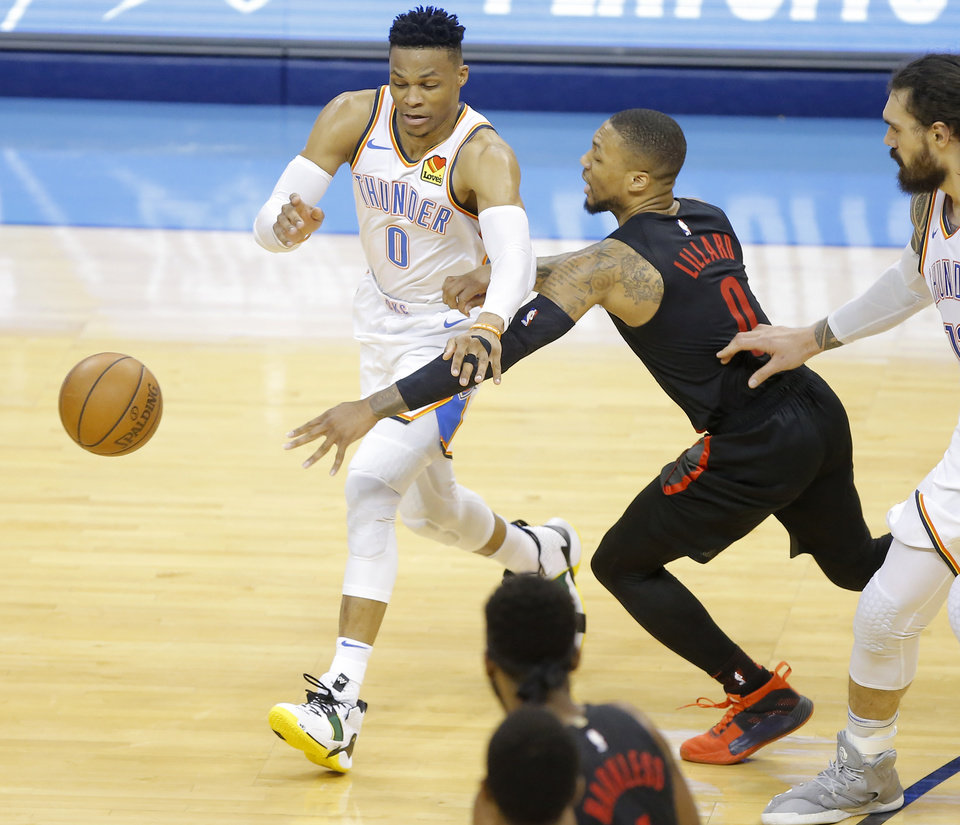Photo - Damian Lillard (0) reaches for the ball beside Russell Westbrook (0) during Game 4 in the first round of the NBA playoffs between the Portland Trail Blazers and the Oklahoma City Thunder at Chesapeake Energy Arena in Oklahoma City, Sunday, April 21, 2019. Portland won 11-98.  Photo by Bryan Terry, The Oklahoman