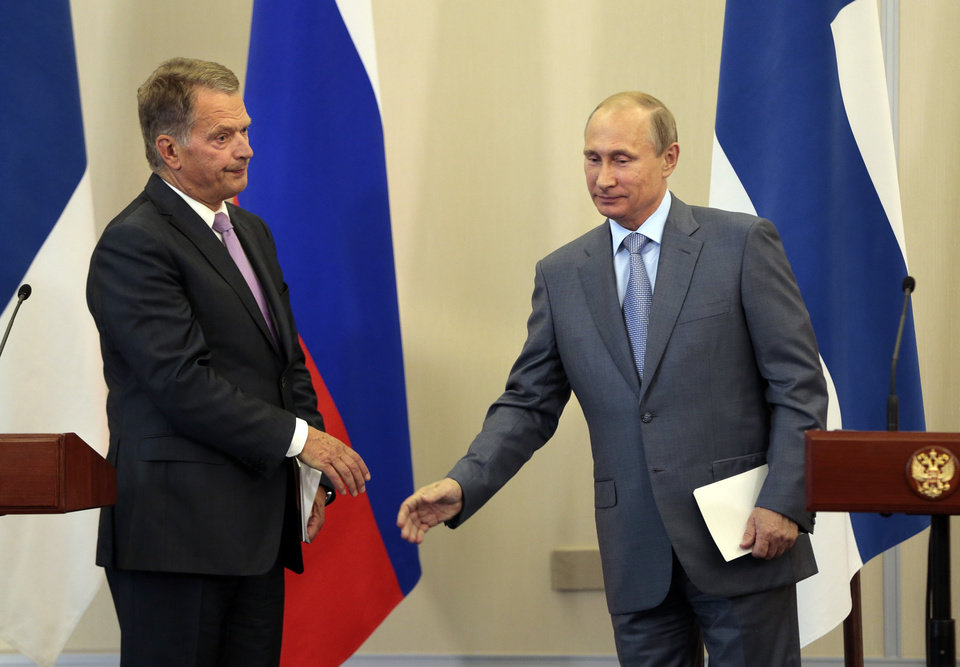 Photo - Russian President Vladimir Putin, right, shakes hands with Finnish President Sauli Niinisto finishing their news conference after the talks at the residence at the Black Sea resort of Sochi, southern Russia, in Sochi, Russia, Friday, Aug. 15, 2014. Putin met with Niinisto here on Friday to discuss interaction between the two countries, as well as international problems, first of all, the situation in Ukraine, the Kremlin press service reported. (AP Photo/Ivan Sekretarev)